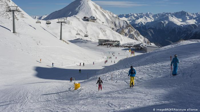People skiing down the slopes of the winter resort of Silvretta Arena, Ischgl, Austria