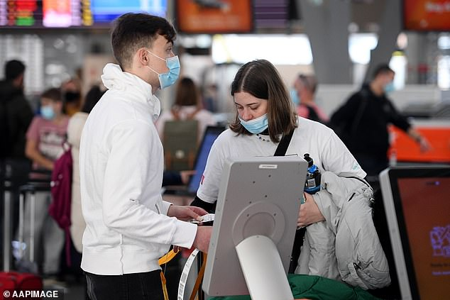 Australians will be allowed on overseas holidays even if some state borders are still closed when 80 per cent are vaccinated, Scott Morrison confirmed. Pictured: Sydney passengers before lockdown