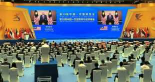 Business message: The audience listening to Ismail Sabri's pre-recorded speech during the opening ceremony in Nanning.